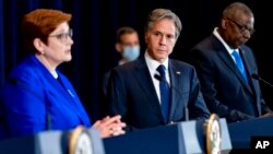Australian Foreign Minister Marise Payne, left, accompanied by US Secretary of State Antony Blinken, second from right, and US Defense Secretary Lloyd Austin, right, speaks at a news conference at the State Department in Washington, Sept. 16, 2021.