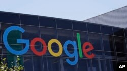 FILE - This July 19, 2016, file photo shows the Google logo at the company's headquarters in Mountain View, California.