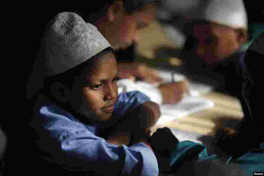 A student in a Madrasa reads the Koran during the holy month of Ramadan, in Old Dhaka, Bangladesh, July 1, 2014.