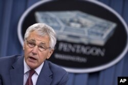 Defense Secretary Chuck Hagel speaks during a news conference at the Pentagon, July 31, 2013.