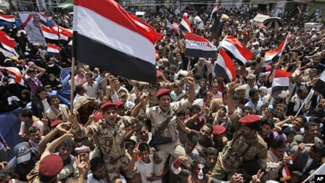 Yemeni army soldiers lifted by anti-government protestors, chants slogans and wave their national flag as they celebrate President Ali Abdullah Saleh's departure to Saudi Arabia, in Sanaa, Yemen, Sunday, June 5, 2011