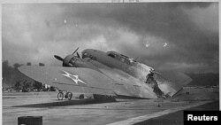 A burnt B-17C aircraft rests near Hangar Number Five, Hickam Field, following the attack by Japanese aircraft on Pearl Harbor, Hawaii December 7, 1941. December 7, 2011 marks the 70th anniversary of the Pearl Harbor attack in which over 2,400 members of t