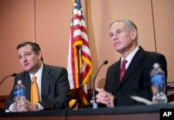 Republican presidential candidate Sen. Ted Cruz, R-Texas, left, and Texas Gov. Greg Abbott, right, speak about the resettlement of Syrian refugees in the U.S., during their joint news conference on Capitol Hill in Washington, Dec. 8, 2015.