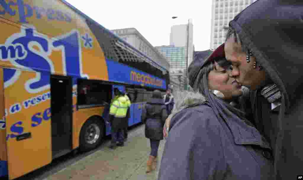 Shay Owens kisses her boyfriend, Bryan Jordan, before boarding a Megabus in Chicago, Illinois for a trip to Atlanta, Georgia, Nov. 26, 2013.