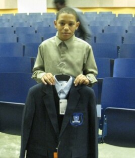 Jamarcus Preston, who will be entering 6th grade at Obama Academy, shows off his new school uniform.