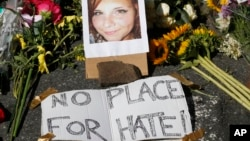 A makeshift memorial of flowers and a photo of victim, Heather Heyer, sits in Charlottesville, Va., Aug. 13, 2017. Heyer died when a car rammed into a group of people who were protesting the presence of white supremacists who had gathered in the city for a rally.