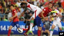 18일 한국 울산 문수축구경기장에서 열린 '2014 브라질월드컵' 아시아지역 최종 예선 A조 마지막 경기. 한국은 이란에 0:1로 패했지만, 골득실차로 본선 진출에 성공했다.