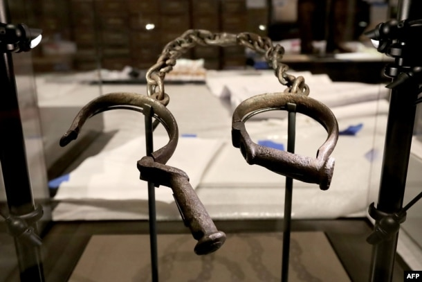 FILE - A pair of slave shackles are on display in the Slavery and Freedom Gallery in the Smithsonian's National Museum of African American History and Culture during the press preview on the National Mall in Washington, D.C., Sept. 14, 2016.