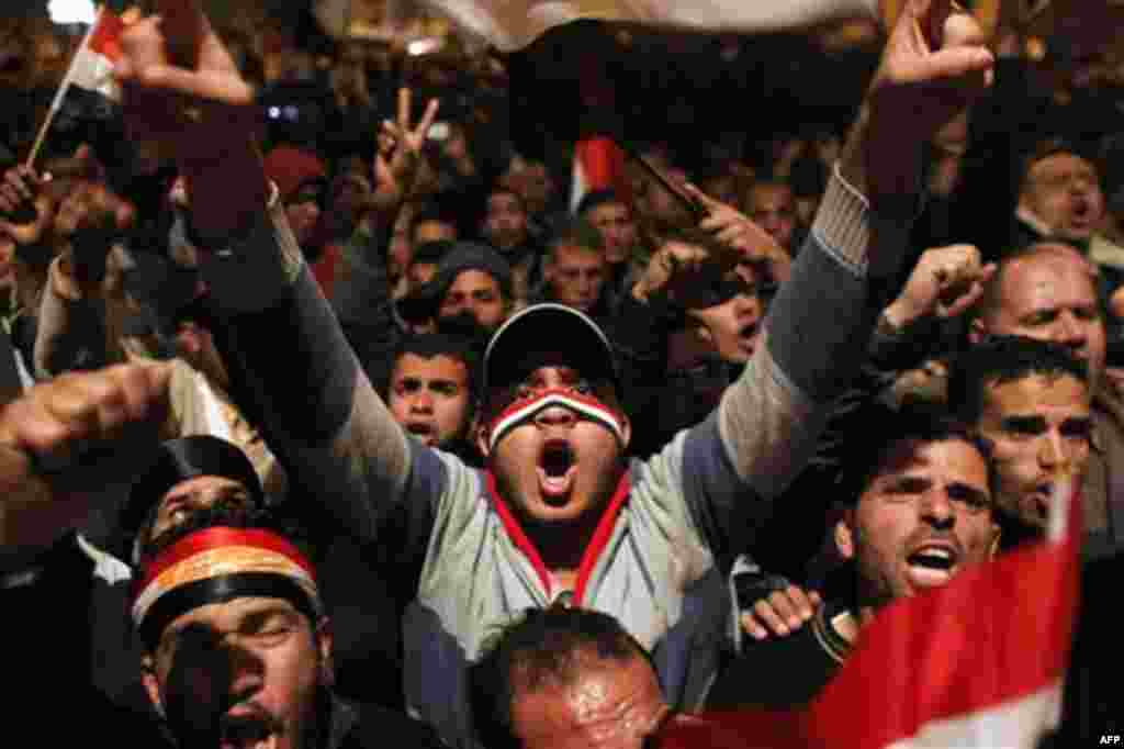 Anti-government protesters demonstrate in Tahrir Square in downtown Cairo, Egypt Thursday, Feb. 10, 2011. Thousands of state workers and impoverished Egyptians launched strikes and protests around the country on Thursday over their economic woes as anti-g