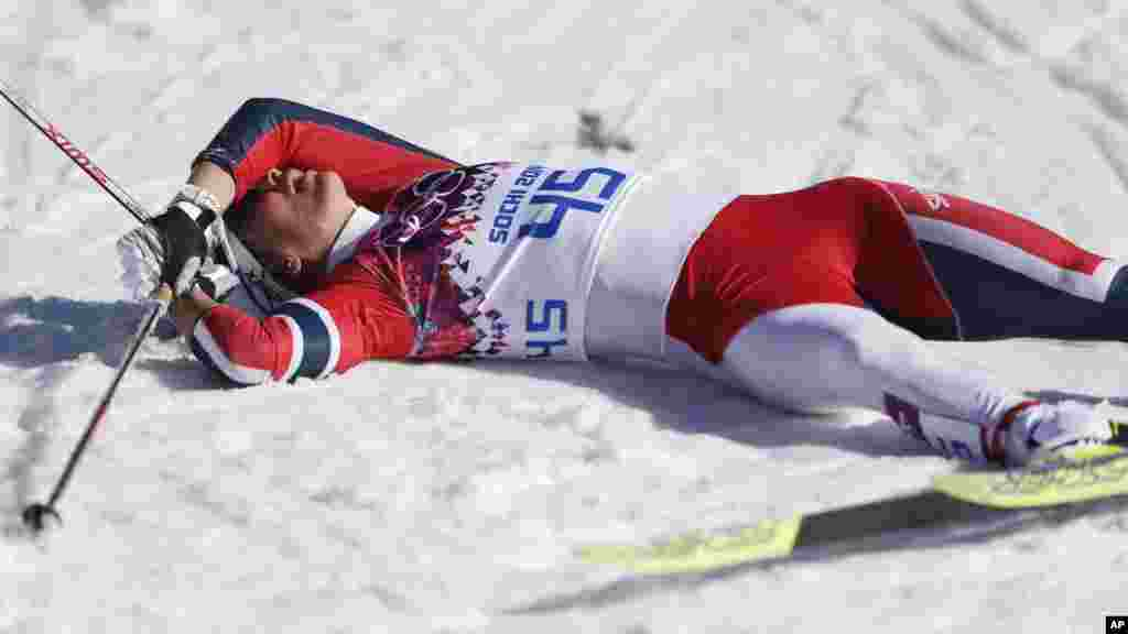 Norway's Marit Bjoergen catches her breath after the women's 10K classical-style cross-country race at the 2014 Winter Olympics, Feb. 13, 2014.