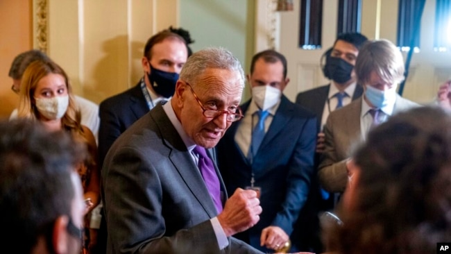 FILE - Senate Majority Leader Chuck Schumer, D-N.Y., speaks to reporters as work continues on the Democrats' Build Back Better Act, massive legislation that is a cornerstone of President Joe Biden's domestic agenda, at the Capitol, in Washington, Sept. 14