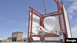 A Project Loon balloon is readied for launch.