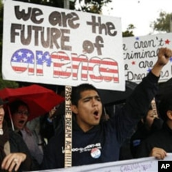 Undocumented college student Jorge Herrera, 18, center, of Carson, California, rallies with students and Dream Act supporters in Los Angeles, 18 Dec 2010