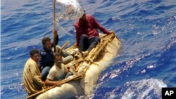 FILE - Cuban refugees float in heavy seas 60 miles south of Key West, Florida, Aug. 26, 1994.