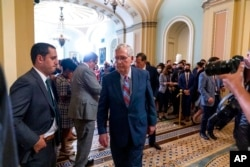 FILE - Senate Minority Leader Mitch McConnell, R-Ky., walks away after speaking with reporters as work continues on the Democrats' Build Back Better Act, massive legislation that is a cornerstone of President Joe Biden's domestic agenda, at the Capitol, i