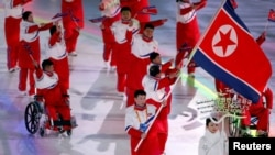 Jong Hyon Kim of North Korea carries the national flag during the opening ceremony, March 9, 2018, at the Pyeongchang 2018 Winter Paralympics in Pyeongchang, South Korea.