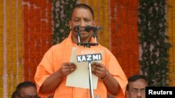 India's ruling Bharatiya Janata Party (BJP) leader Yogi Adityanath takes the oath as the new chief minister of India's most populous state of Uttar Pradesh during a swearing-in ceremony in Lucknow, India, March 19, 2017.