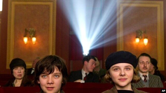 Left to right: Asa Butterfield plays Hugo Cabret and Chloë Grace Moretz plays Isabelle in HUGO, from Paramount Pictures and GK Films.