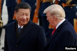 FILE - U.S. President Donald Trump takes part in a welcoming ceremony with China's President Xi Jinping at the Great Hall of the People in Beijing, China, Nov. 9, 2017.