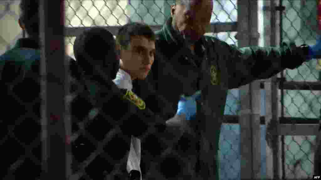 This video screen grab image shows shooting suspect Nikolas Cruz at Broward County Jail in Ft. Lauderdale, Florida, Feb. 15, 2018. The heavily armed teenager who gunned down students and adults at a Florida high school was charged with 17 counts of premeditated murder, court documents showed.