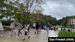 Students walking on campus near Forbes Avenue at Carnegie Mellon University.