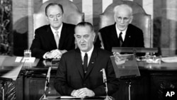 In this March 15, 1965 file photo, President Lyndon B. Johnson addresses a joint session of Congress in Washington, during which he urged the passing of the Voting Rights Act.