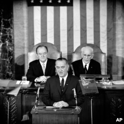 In this March 15, 1965 file photo, U.S. President Lyndon B. Johnson addresses a joint session of Congress in Washington where he urged the passing of the Voting Rights Act.