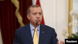 Presiden Turki Recep Tayyip Erdogan dalam kunjungan ke Jakarta (31/7). (Reuters/Darren Whiteside)