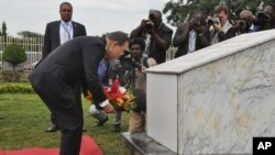 U.N. Secretary General Ban Ki-moon lays a wreath to remember his colleagues that were killed four years ago by a suicide car bombing at U.N offices in Abuja, Nigeria, Aug. 24, 2015.