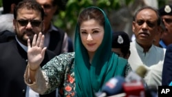 Maryam Nawaz, center, the daughter of Pakistani prime minister Nawaz Sharif, talks with media following an appearance before a panel investigating the Sharif family's offshore companies and claims of money laundering, in Islamabad, July 5, 2017.