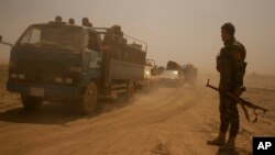FILE - Hundreds of civilians flee villages outside Mosul a day after Iraqi Kurdish forces launched an operation east of Islamic State-held Mosul, Aug. 15, 2016.