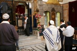 FILE - Syrian Jews celebrate Passover at the al-Firenj Synagogue in downtown Damascus, Syria, April 20, 2008.