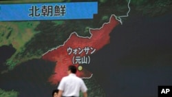 A screen shows a news program reporting about North Korea's missile firing from Wonsan, June 8, 2017.