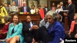 A photo shot and tweeted from the floor of the U.S. House of Representatives by Rep. Katherine Clark shows Democratic members staging a sit-in on the House floor in support of action on gun control, June 22, 2016.