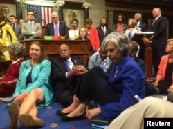"A photo shot and tweeted from the floor of the U.S. House of Representatives by Rep. Katherine Clark shows Democratic members of the House staging a sit-in on the House floor ""to demand action on common sense gun legislation"" on Capitol Hill in Washington."