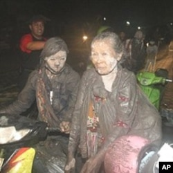 Villagers flee their homes following another eruption from Mount Merapi in Klaten, Indonesia, 05 Nov 2010