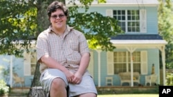 FILE - Transgender high school student Gavin Grimm poses in front of his home in Gloucester, Va., Aug. 22, 2016. The Supreme Court will take up transgender rights for the first time in the case of a Virginia school board that wants to prevent Grimm, a transgender teenager, from using the boys' bathroom at his high school.
