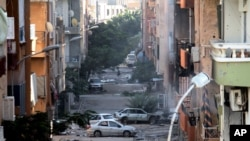 FILE - Damage resulting from clashes between the Libyan military and Islamic militias is seen in Benghazi, Oct. 29, 2014.