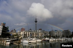 FILE - A rainbow appears on the Auckland skyline featuring Sky Tower in New Zealand, July 8, 2017.