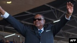 FILE: Malawi's President elect Arthur Peter Mutharika waves to supporters during the swearing in ceremony at Kamuzu Stadium in Blantyre on May 28, 2019, after a contentious election marred by allegations of fraud and vote-rigging.