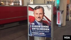 Norbert Hofer's campaign posters have been defaced, reflecting Austria's angry and divisive campaign. This one, in central Vienna, shows a mustache depicting Hofer as Hitler. (L. Ramirez/VOA)