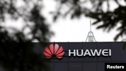 FILE - The Huawei logo is pictured outside the company's research facility in Ottawa, Ontario, Canada.