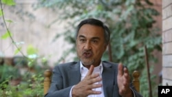 In this Tuesday, Aug 18, 2015, photo, Mohammad Daud Sultanzoy, a former lawmaker overseeing the handover of military airports for the Afghan government, speaks during an interview with the Associated Press in Kabul, Afghanistan.