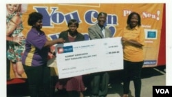 Representatives of Africa Lotto with lotto winner, Nobert Elvis Kufakunesu, and his wife, Edith.