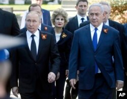 FILE - Russian President Vladimir Putin, left, and Israeli Prime Minister Benjamin Netanyahu attend a military parade in Red Square, Moscow, Russia, May 9, 2018.