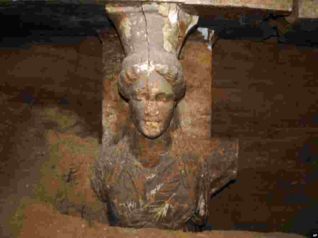A photo shows a 60 centimeter (2 foot) female figurine on a wall leading to the yet unexplored main room of an ancient tomb, in the town of Amphipolis, northern Greece, released by the Greek Culture Ministry, Sept. 7, 2014.