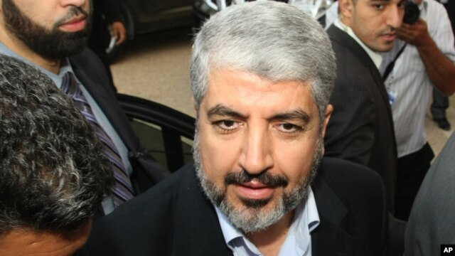 Hamas leader Khaled Meshaal arrives at the Islamist Ennahda party congress in Tunis,  July, 12, 2012.