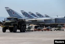 FILE - Russian military jets are seen at Hmeimim air base in Syria, June 18, 2016.