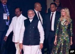 Indian PM Narendra Modi, U.S. presidential adviser and daughter Ivanka Trump, and Telangana state Chief Minister K. Chandrashekara Rao arrive for the opening of the Global Entrepreneurship Summit in Hyderabad, Nov. 28, 2017.