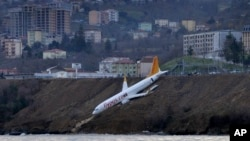 A Boeing 737-800 of Turkey's Pegasus Airlines after skidding off the runway downhill towards the sea at the airport in Trabzon, Jan. 14, 2018.